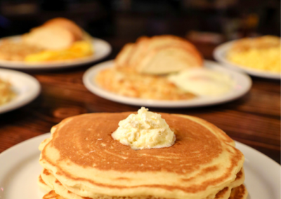 Picture of Pancakes with other breakfast in the background